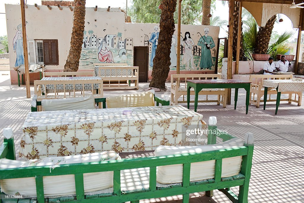 Police officers sit inside a deserted coffee shop in Luxor, Egypt, on Thursday, April 25, 2013. Egypt ranked last in terms of security and safety on the World Economic Forum's 2013 Travel and Tourism Competitiveness Index. Photographer: Shawn Baldwin/Bloomberg via Getty Images