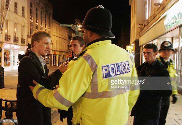 Police officers speak to a group of men in the early hours as part of an operation to enforce the new licensing laws and clampdown on alchohol...