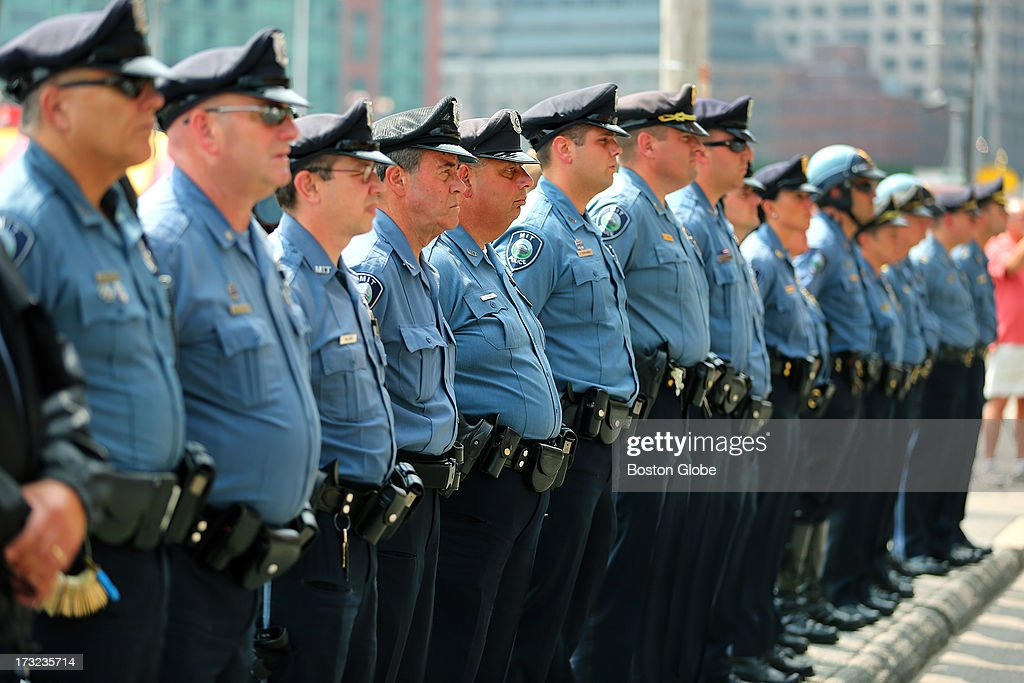 MIT police officers stand at attention across the street from the courthouse. Alleged Boston Marathon bomber Dzhokhar Tsarnaev appeared for an arraignment at the John Joseph Moakley United States Courthouse to face charges in the Boston Marathon bombings.
