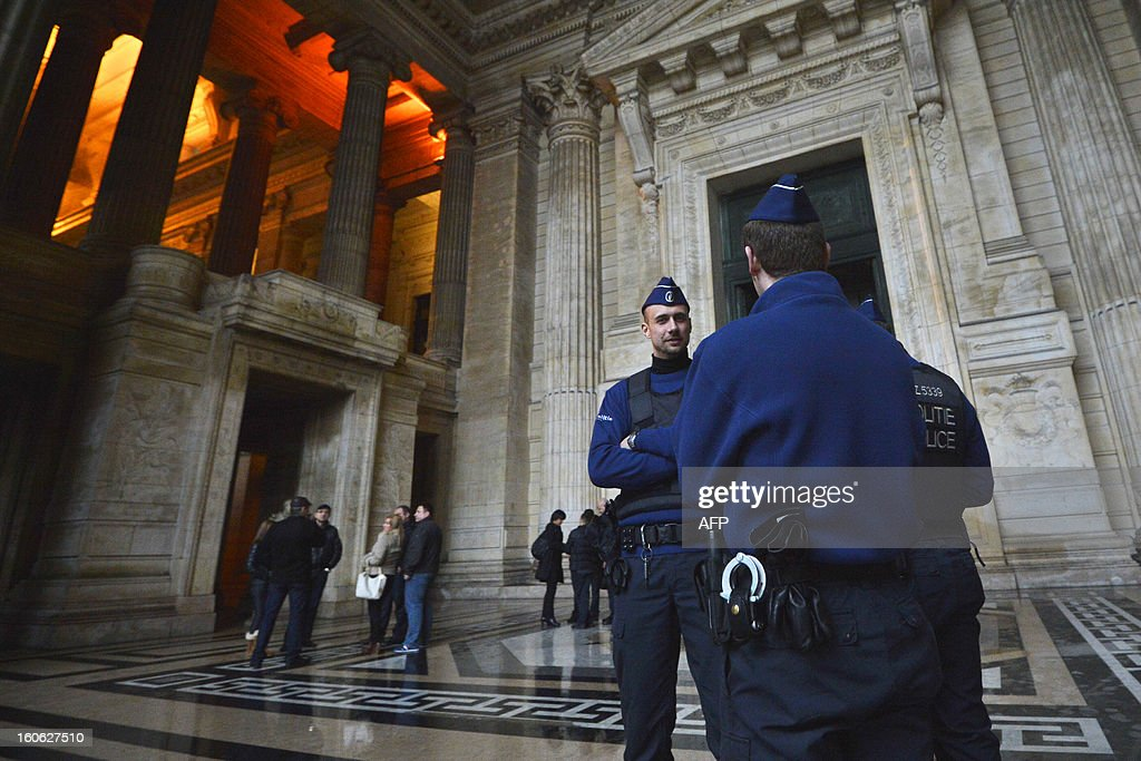 Police officers stand at the Brussels courthouse prior the appearance of pedophile Marc Dutroux before the execution court on February 4, 2013 after requesting electronic home arrest. Belgian serial killer, child abductor and molester Marc Dutroux was convicted to life imprisonment.