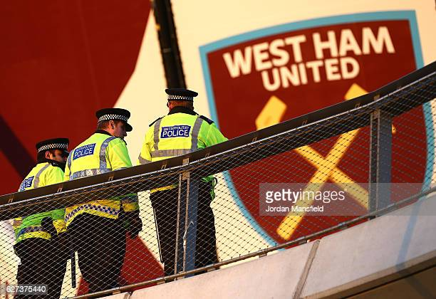 Police officers stand at the stadium prior to the Premier League match between West Ham United and Arsenal at London Stadium on December 3 2016 in...