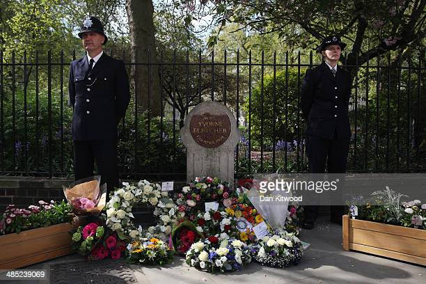 Police officers stand beside a memorial stone during a memorial service for the murdered Police woman Yvonne Fletcher in St James' Square on April 17...