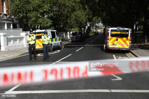 Police officers stand by a cordon at Parsons Green Underground Station on September 15 2017 in London England Several people have been injured after...