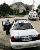 Police officers stand by at the home of astronaut Lisa Marie Nowak on February 7 2006 in Houston Texas Nowak has been charged with attempted murder...