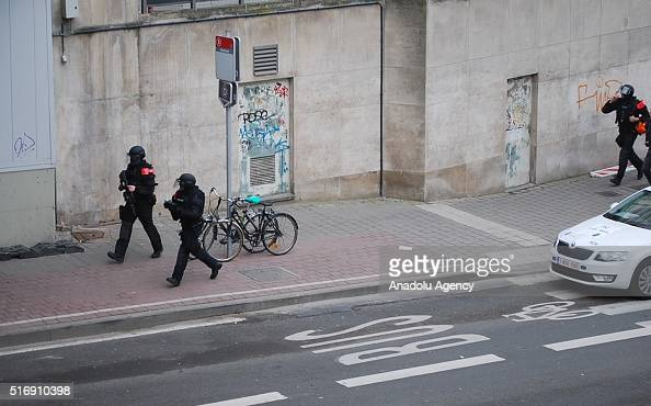 Police officers stand guard around the Maalbeek Metro station following a blast at the station in Brussels Belgium on March 22 2016