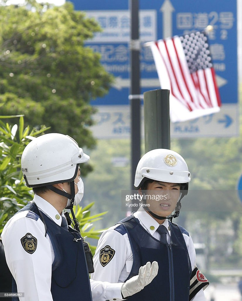 Police officers stand guard around the Peace Memorial Park in the western Japan city of Hiroshima on May 27, 2016, before U.S. President Barack Obama visits the atomic-bombed city later in the day.