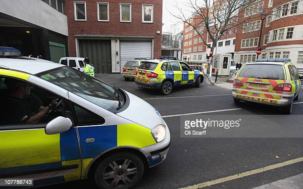Police officers stand guard as a van carrying men charged with conspiracy to cause explosions in the UK arrives at Westminster Magistrates Court on...