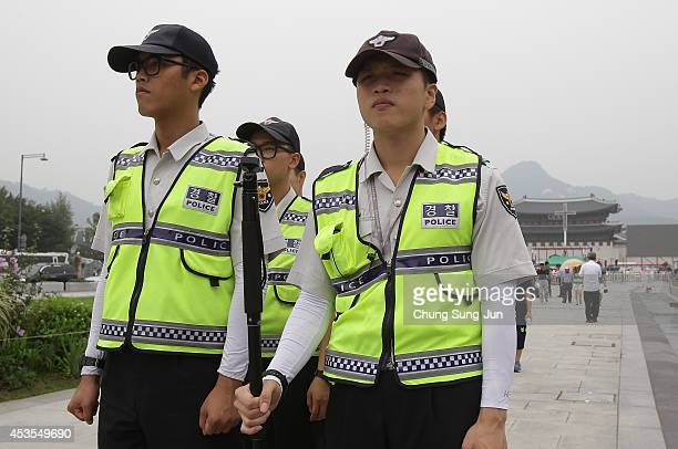 Police officers stand guard as set up a platform in prepare for a special holy mass on August 13 2014 in Seoul South Korea Pope Francis will be...
