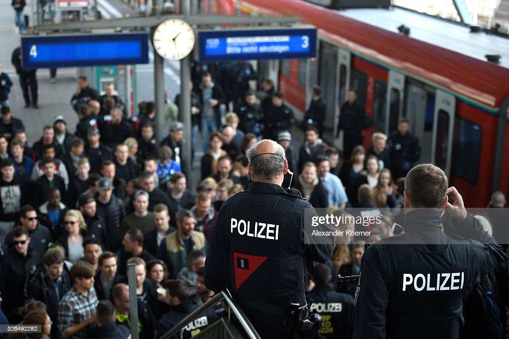 Police officers stand guard at a platform at central station Darmstadt prior to the Bundesliga Match of SV Darmstadt 98 and Eintracht Frankfurt at Merck-Stadion am Boellernfalltoron April 30, 2016 in Darmstadt, Germany. The city of Darmstadt ordered a ban on fans of Eintracht Frankfurt entering the city for 36 hours, which has now been overturned.