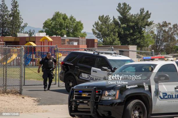 Police officers stand guard at North Park Elementary School following a shooting on campus on April 10 2017 in San Bernardino California Two people...