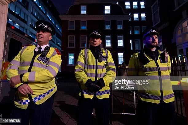 Police officers stand guard at the Conservative Party's Headquarters during the Stop The War Coalition's emergency protest on December 1 2015 in...