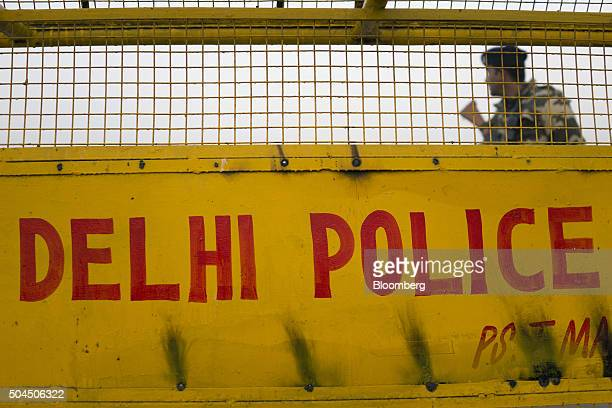 Police officers stand guard at the India Gate monument shrouded in smog in New Delhi India on Monday Jan 11 2016 A 2judge Delhi High Court panel...