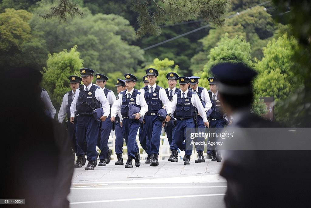 Police officers stand guard at the Ise Shrine as Shinzo Abe, Prime Minister of Japan received G7 leaders in front of Uji-bashi Bridge at Ise Shrine as an official welcome event of the Summit on May 26, 2016, in Ise, Mie Prefecture, Japan. G7 Summit 2016 is held in Ise-Shima in Mie Prefecture in Japan during two days from May 26 to 27, 2016 as Japan assumed the Presidency of the Summit.