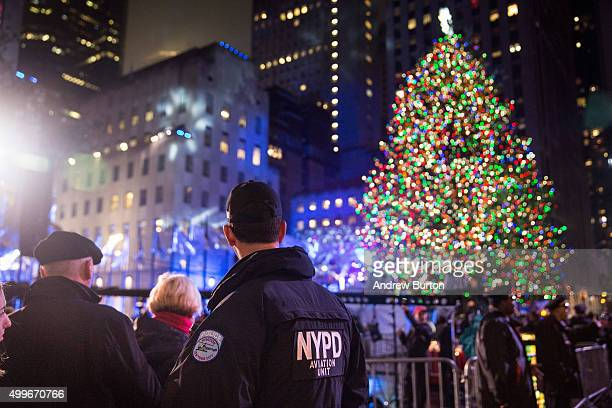 Police officers stand guard at the Rockefeller Center complex during the annual lighting of the Rockefeller Center Tree on December 2 2015 in New...