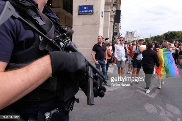 Police officers stand guard during the Paris Gay Pride Parade or known as Marche des Fiertés LGBT in France on June 24 2017 in Paris France