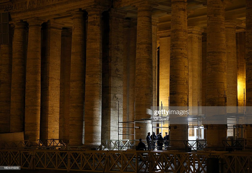 Police officers stand guard in front of the illuminated colonnade in Saint Peter's Square on February 23, 2013 in Vatican City, Vatican. Pope Benedict XVI is due to hold his last weekly public audience tomorrow before he retires on Thursday. Pope Benedict XVI has been the leader of the Catholic Church for eight years and is the first Pope to retire since 1415. He cites his retirement due to ailing health and is to spend the rest of his life in solitude away from any public engagements.