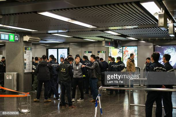 Police officers stand guard inside Tsim Sha Tsui MTR station on February 10 2017 in Hong Kong A 60 yearold man set a fire with a fuelfilled bottle as...