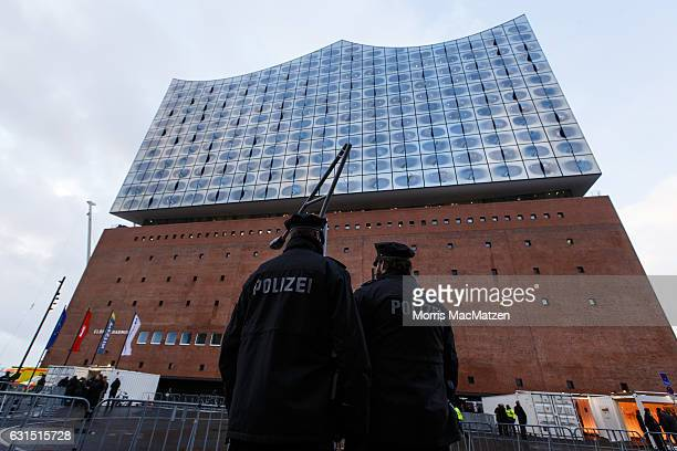 Police officers stand guard near the Elbphilharmonie concert hall during the opening on January 11 2017 in Hamburg Germany Tonights opening gala...