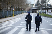 Police officers stand guard on a road near Maelbeek Station following todays attack on March 22 2016 in Brussels Belgium At least 30 people are...