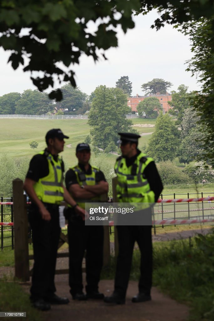 Police officers stand guard on the roads surrounding The Grove hotel which is hosting the annual Bilderberg conference on June 6, 2013 in Watford, England. The traditionally secretive conference, which has taken place since 1954, is expected to be attended by politicians, bank bosses, businessman and European royalty.