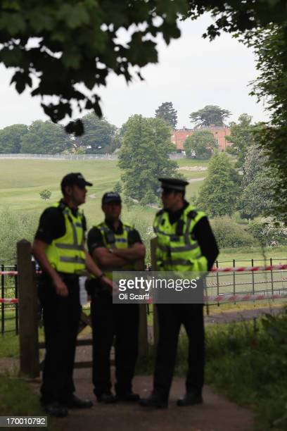 Police officers stand guard on the roads surrounding The Grove hotel which is hosting the annual Bilderberg conference on June 6 2013 in Watford...