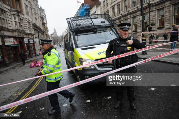 Police officers stand guard on Whitehall following yesterday's attack on March 23 2017 in London England Four people have been killed and around 40...