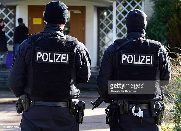 Police officers stand guard outside a synagogue on March 1 2015 in Bremen Germany Bremen is on high alert after authorities yesterday reported they...