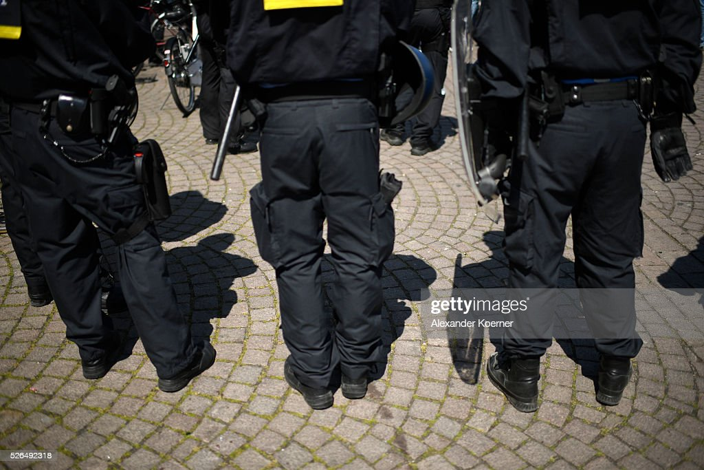 Police officers stand guard outside central station Darmstadt prior to the Bundesliga Match of SV Darmstadt 98 and Eintracht Frankfurt at Merck-Stadion am Boellernfalltoron April 30, 2016 in Darmstadt, Germany. The city of Darmstadt ordered a ban on fans of Eintracht Frankfurt entering the city for 36 hours, which has now been overturned.