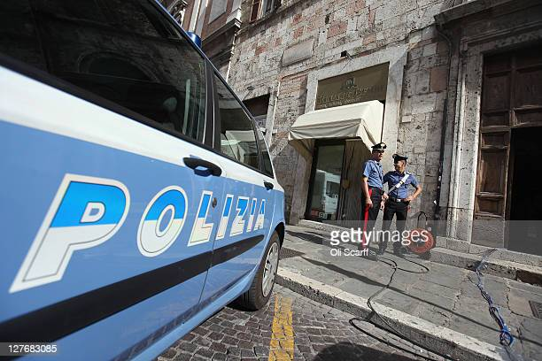 Police officers stand guard outside Perugia's Court of Appeal on September 30 2011 in Perugia Italy Amanda Knox and Raffaele Sollecito are awaiting...