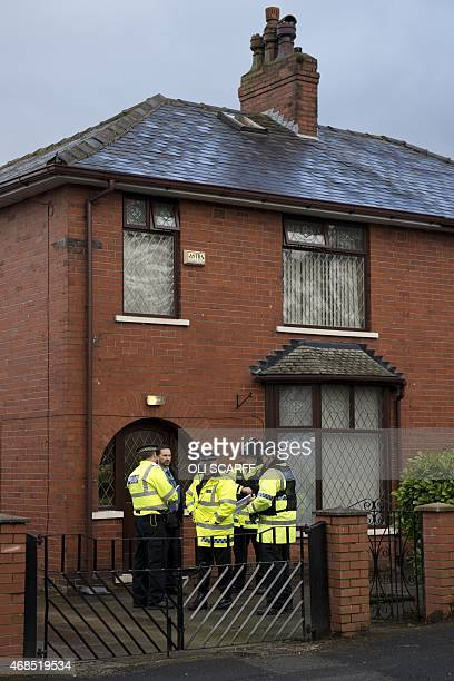 Police officers stand guard outside the family home of one of nine British citizens currently detained by Turkish authorities for allegedly...