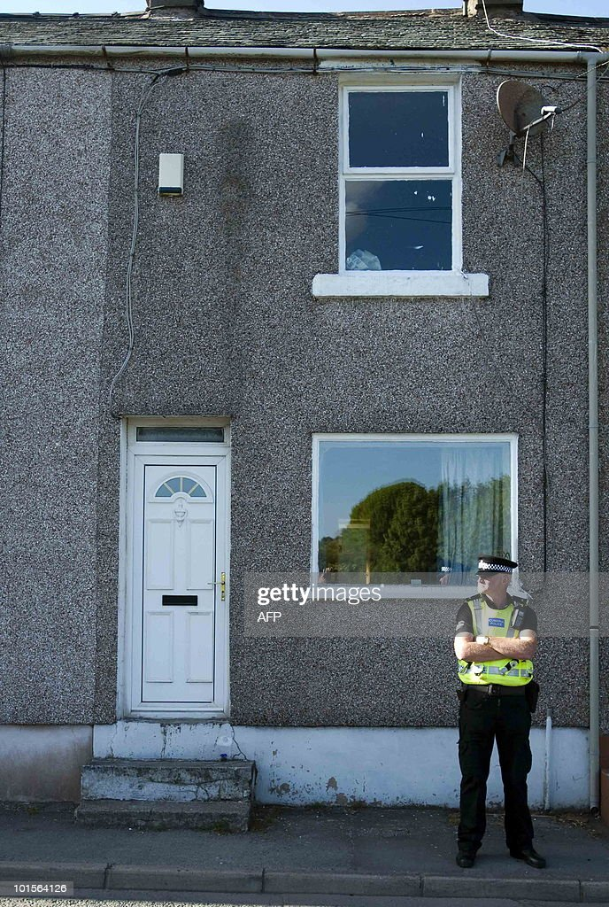 Police officers stand guard outside the home of Derrick Bird, in Rowrah, Cumbria, north west England on June 2, 2010. A gunman killed at least 12 people in a deadly rampage through a popular tourist region in northwest England Wednesday, before apparently turning the gun on himself, police said. Some 25 people were injured, three critically, when 52-year-old taxi driver Bird spent over three hours driving through the Lake District, reportedly shooting at people from his car window. AFP PHOTO/Derek Blair