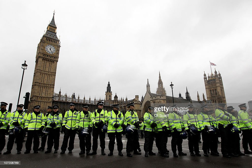 Police officers stand guard outside the Houses of Parliament as students take part in a protest over the Government's budget cuts and proposed rise in tuition fees on November 30, 2010 in London, England. Hundreds of students evaded police containment tactics and marched throughout Westminster and the City of London from Trafalgar Square in the third major protest of its kind in London in as many weeks.