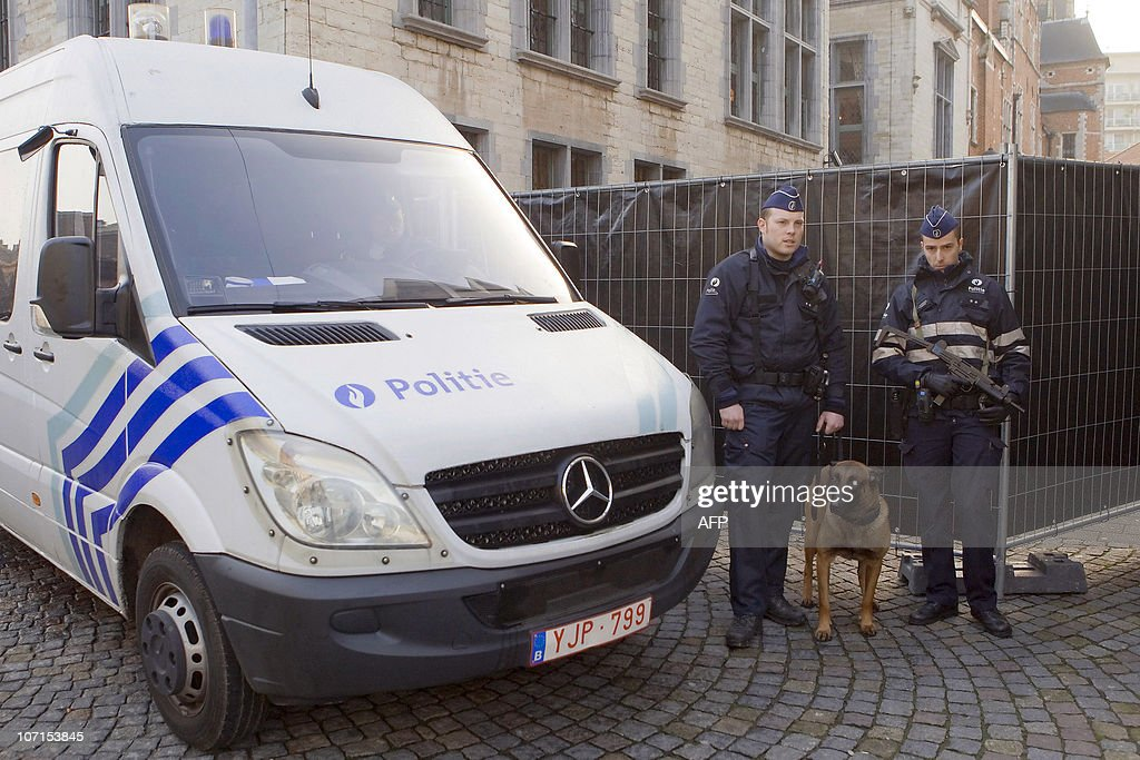 Police officers stand guard outside the Palace of Justice in Mechelen on November 26 2010 Seven men who were arrested on November 23 suspected both...