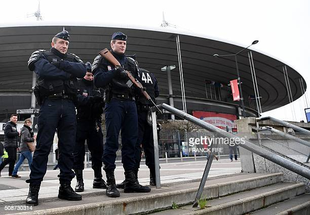 Police officers stand guard outside the StadedeFrance stadium in SaintDenis north of Paris on February 6 prior to the Six Nations international rugby...
