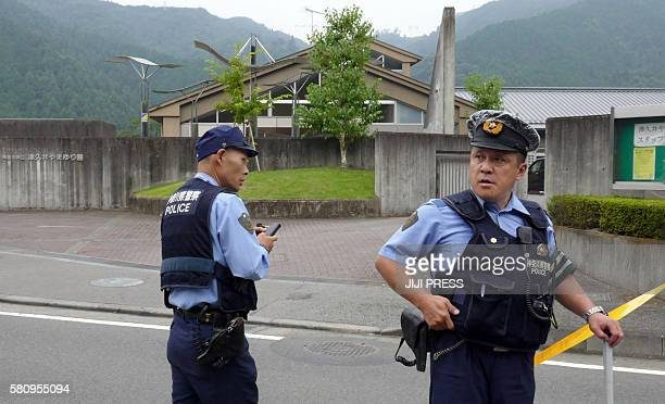 Police officers stand guard outside the Tsukui Yamayuri En a care centre where a knifewielding man went on a rampage at Sagamihara city Kanagawa...