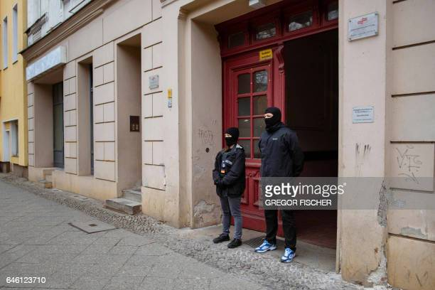 Police officers stand in front of the 'Fussilet 33' mosque in Berlin on February 28 2017 German authorities have closed a radical mosque in Berlin...
