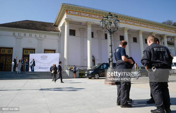 Police officers stand in front of the Kurhaus one day before the gathering of G20 finance ministers and central bankers in BadenBaden southern...