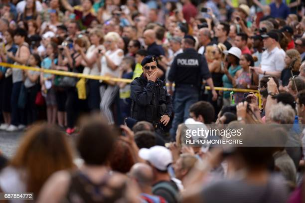 Police officers stand in front of tourists waiting for Ivanka Trump daughter of US President Donald Trump and her husband Jared Kushner senior...