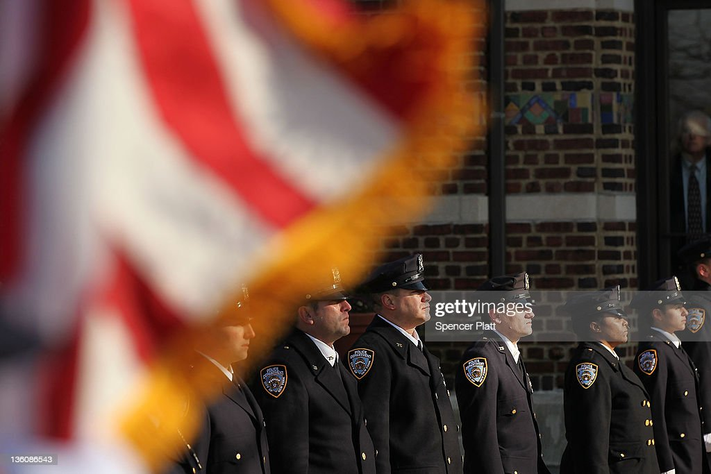 NYPD police officers stand in line as they attend the funeral of Officer Peter Figoski who was killed last week while responding to a robbery at St...