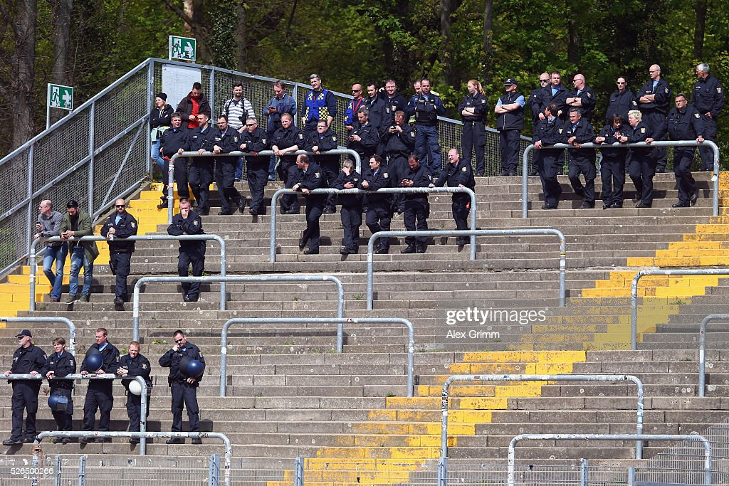 Police officers stand in the empty Frankfurt block during the Bundesliga match between SV Darmstadt 98 and Eintracht Frankfurt at Merck-Stadion am Boellenfalltor on April 30, 2016 in Darmstadt, Hesse.