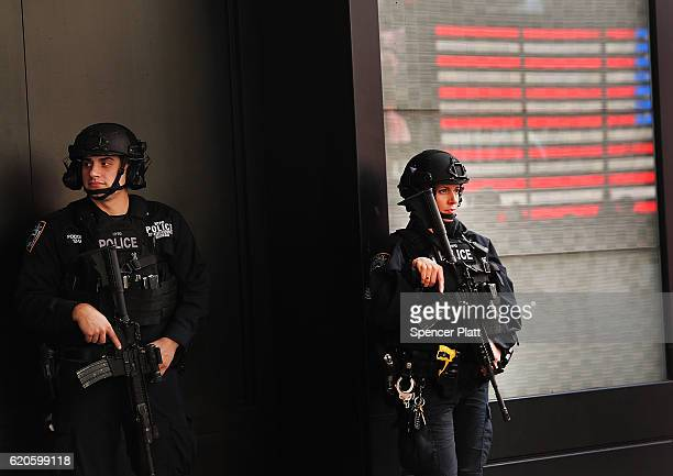 Police officers stand in Time Square on November 2 2016 in New York City With the US presidential election only days away many Americans are feeling...