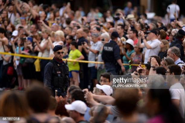 Police officers stand infront of tourists waiting for Ivanka Trump daughter of US President Donald Trump and her husband Jared Kushner senior adviser...