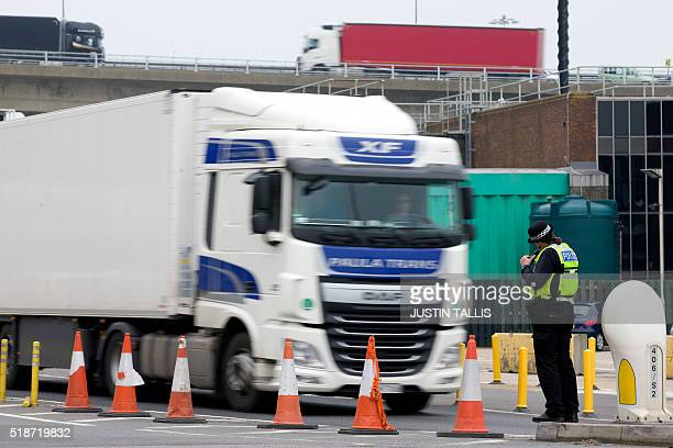 Police officers stand near the Ferry terminal as antiracism demonstrators block the route of a planned far right march through Dover southern England...