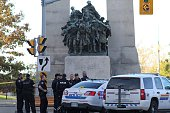 Police officers stand near the National War Memorial in Ottawa Canada on October 22 2014 A gun man opened fire at the National War Memorial and...