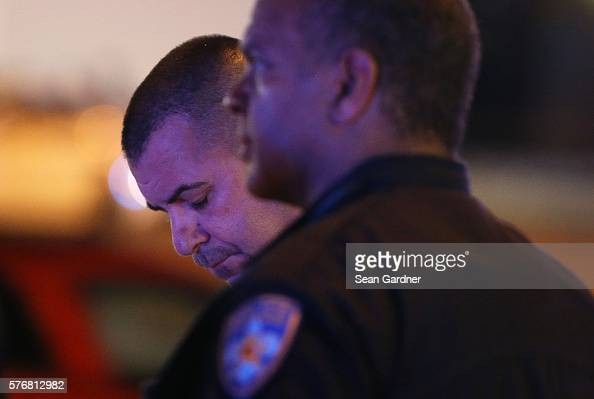 Police officers stand near the scene of where three police officers were killed this morning on July 17 2016 in Baton Rouge Louisiana The suspect...