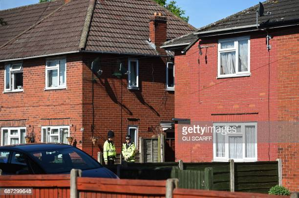 Police officers stand on duty outside a house on Elsmore Road in Fallowfield Manchester in northwest England on May 23 as they search the resdiential...