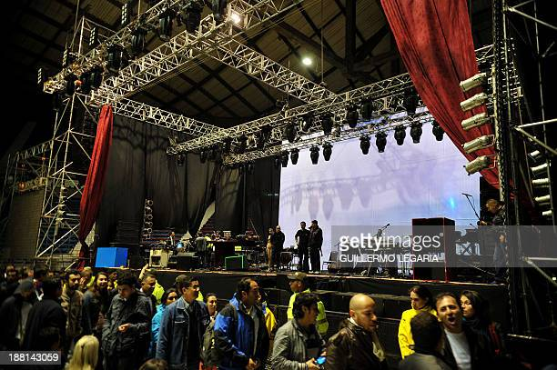 Police officers stand on stage as the audience departs following the announcement that Argentine musician Charly Garcia had had taken ill on his way...