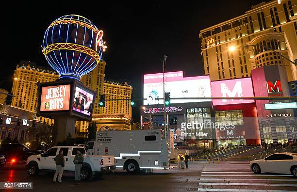 Police officers stand on the Las Vegas Strip which was closed to all vehicle traffic after a car crashed into a group of pedestrians on the sidewalk...