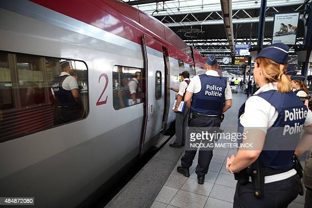 Police officers stand on the platform at the ZuidMidi railway station in Brussels on August 22 a day after a shooting occurred on board of an...