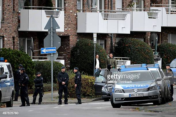 Police officers stand outside a house in Schaufenberger Strasse where heavilyarmed members of the German SEK special forces police unit made arrests...